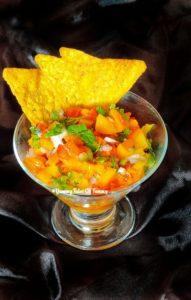 7 ingredient fresh mango salsa served in glass
