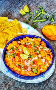 7 Ingredient Fresh Mango Salsa served in blue plate with nachos