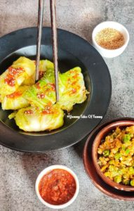 Chinese Steamed cabbage rolls (vegetarian) on a black plate