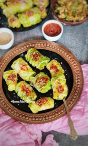 Chinese Steamed cabbage rolls kept in black plate