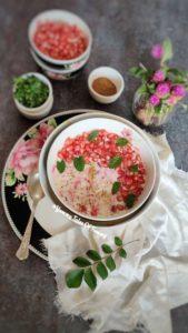 Beetroot Potato Pomegranate Raita served in white bowl