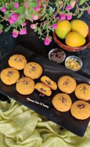 Mango Chocolate Cookies | Mango Cookies served on black tray with mangoes on side
