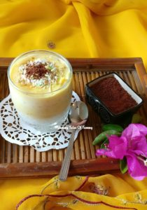 Jackfruit Sago Pudding served in a glass on yellow background